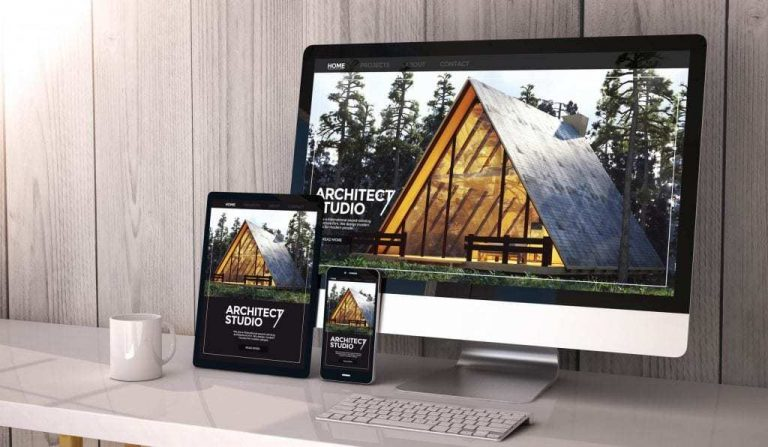 Desktop-tablet-and-mobile-phone-on-desk-all-displaying-the-same-architecture-firms-website-an-example-of-responsive-web-design-1024x596