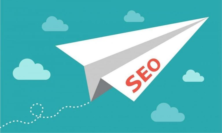 Graphic of paper airplane with SEO on it