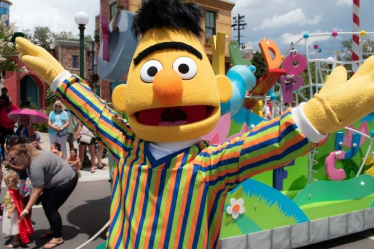 Bert from Sesame Street Waving Arms in the Air at Parade