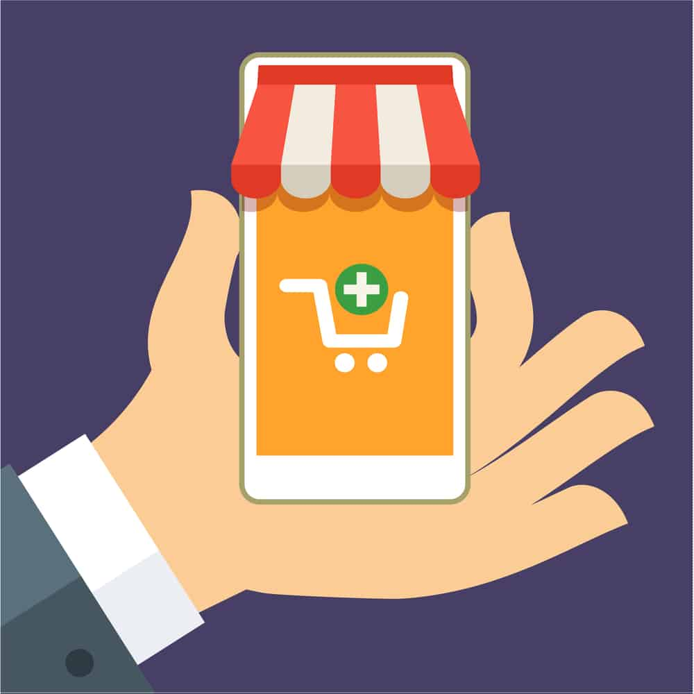 Graphic of hand holding phone with ecommerce symbol and vendor awning